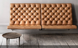 Legless wall attached leather love seat