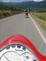 riding a Red vespa on openthe road