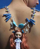Chunky plastic doll necklace
