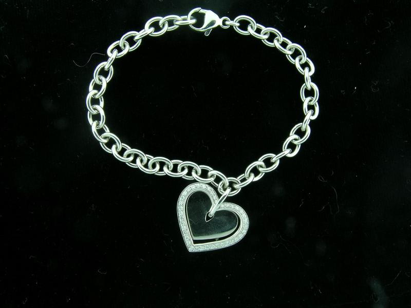 "Heart Charm Bracelet - nothing says ""love"" more than 18kt white gold"